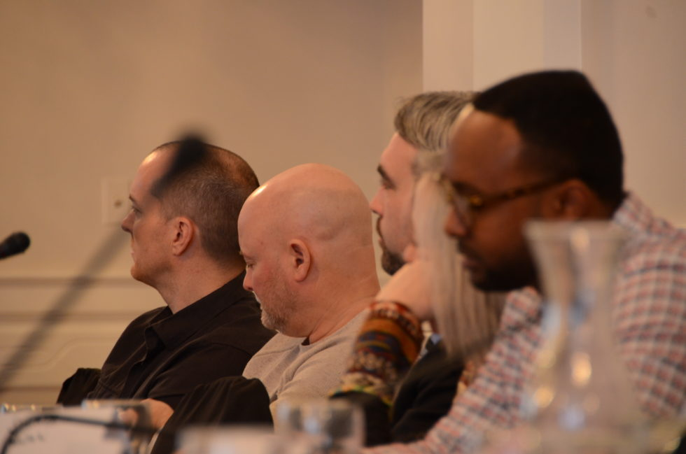 Members of the CMNCP listening intently to a presentation.