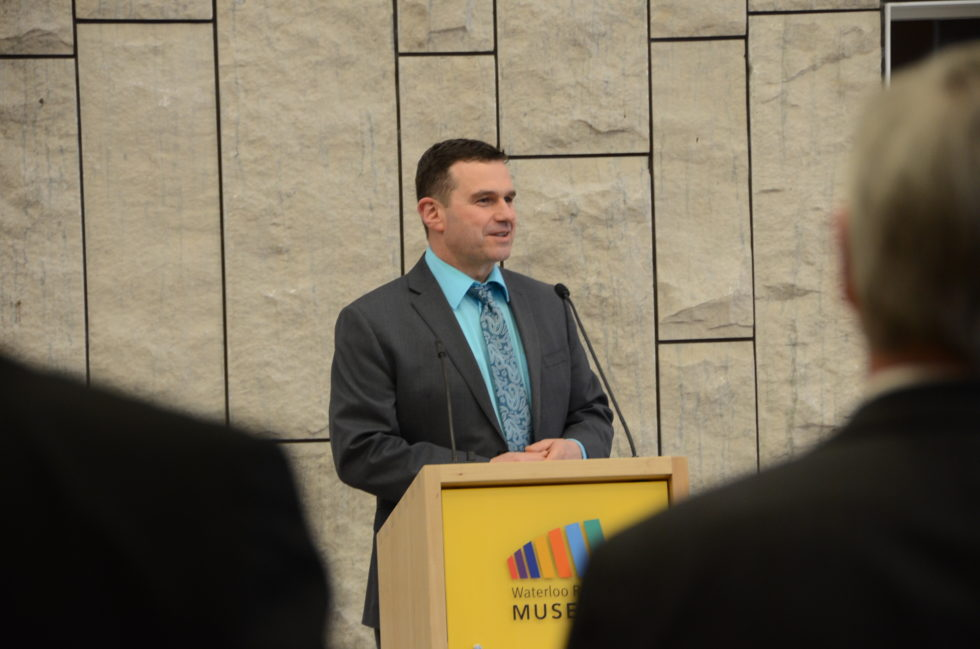 Deputy Chief Kevin Thaler of the Waterloo Region Police Services giving a speech at the reception